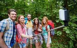 Friends with backpack taking selfie by smartphone Royalty Free Stock Photo