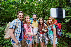 Friends with backpack taking selfie by smartphone Royalty Free Stock Image