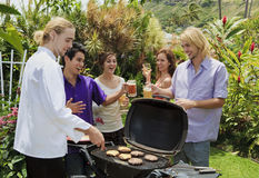 Friends at a backyard bar-b-que Royalty Free Stock Photo