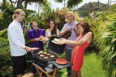 Friends at a backyard bar-b-que. In hawaii Royalty Free Stock Photos