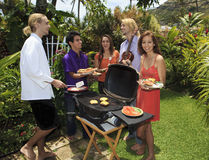 Friends at a backyard bar-b-que Stock Image