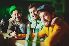 Friends by bar stand Stock Images
