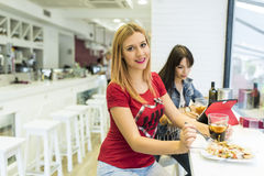 Friends in bar, two girls drinking in restaurant Stock Images