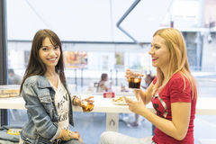 Friends in bar, two girls drinking in restaurant Stock Photography