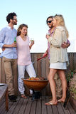 Friends barbecue double date Stock Photo