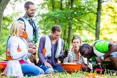 Friends barbecue in forest drinking beer Royalty Free Stock Images