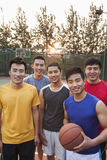 Friends on the basketball court, portrait Stock Images