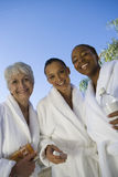 Friends In Bathrobe Smiling Royalty Free Stock Photos
