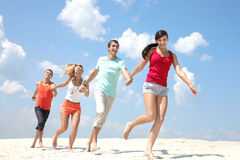 Friends on beach Stock Photography