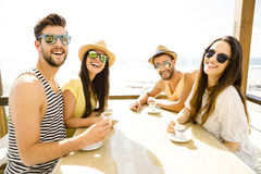 Friends at the beach bar. Fiends having a great time together at the beach bar royalty free stock photography