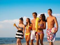Friends on a beach Stock Photos