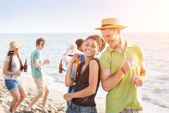 Friends at Beach. Multiracial Group of Friends Having a Party at Beach Royalty Free Stock Photo