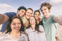 Friends at Beach. Multiracial Group of Friends Taking Selfie at Beach Stock Photo