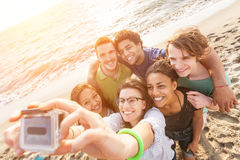 Friends at Beach. Multiracial Group of Friends Taking Selfie at Beach Royalty Free Stock Images