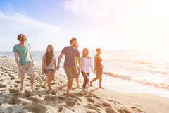 Friends at Beach. Multiracial Group of Friends Walking at Beach Stock Image