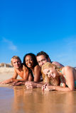 Friends on beach vacation Stock Photography