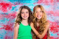 Friends beautiful children girls hug together happy smiling Stock Photos