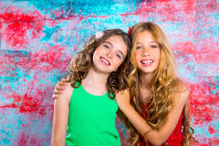 Friends beautiful children girls hug together happy smiling. On grunge background Stock Image