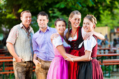 Friends in Beer garden Royalty Free Stock Photography