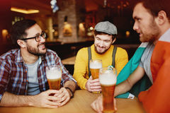 Friends with Beer at Irish Pub Royalty Free Stock Photography