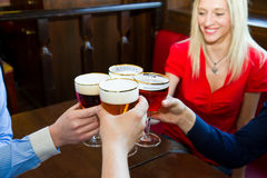 Friends with beer  in a pub. Group of Friends with beer  in a pub Royalty Free Stock Photos