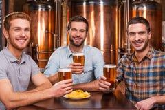 Friends in beer pub. Stock Image