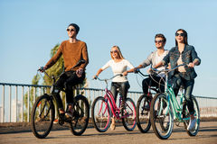 Friends on bicycles. Stock Photos