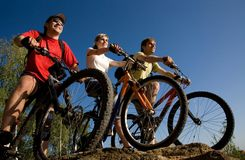Friends bicyclists Stock Photography
