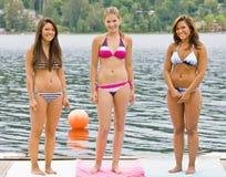 Friends in bikinis on pier Stock Photography