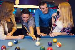 Friends in billard club Stock Photos