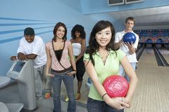 Friends At Bowling Alley Royalty Free Stock Photo