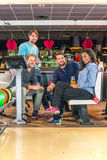 Friends in a bowling alley Royalty Free Stock Photo