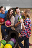 Friends at bowling alley Stock Images