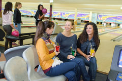 Friends in bowling center. Friends in the bowling center Royalty Free Stock Photo