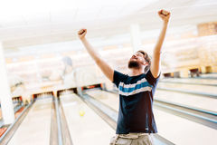 Friends bowling at club Royalty Free Stock Photography