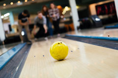Friends bowling at club. And having fun playing casually Royalty Free Stock Images