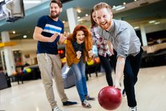 Friends bowling. And enjoying moments together royalty free stock photo