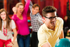 Friends bowling having fun Stock Photography