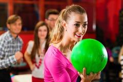 Friends bowling having fun Stock Photos