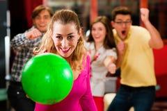 Friends bowling having fun Stock Photo