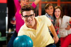 Friends bowling having fun Stock Image