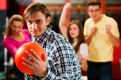 Friends bowling having fun Royalty Free Stock Photos