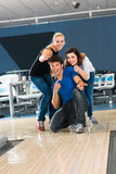 Friends bowling having fun Royalty Free Stock Photo