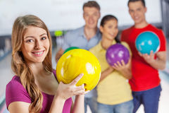 Friends bowling having fun. Group of four friends in a bowling alley having fun royalty free stock photos