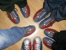 Friends with bowling shoes Stock Image