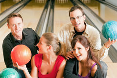 Friends bowling together Royalty Free Stock Photography