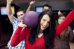 Friends bowling together Royalty Free Stock Images