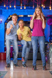Friends bowling together. Royalty Free Stock Images