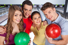 Friends bowling together. Stock Images