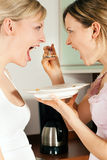 Friends breakfasting cereals Stock Images